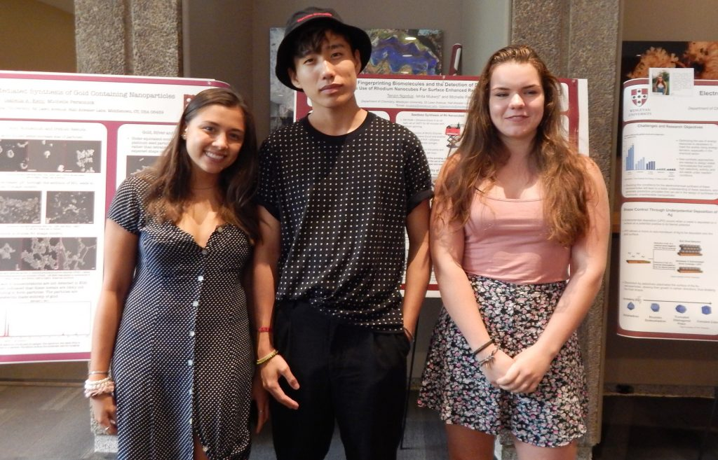 Eija Kent '19, Tenzin Ngodup '20, and Sonja Welch '20 stand in front of their posters